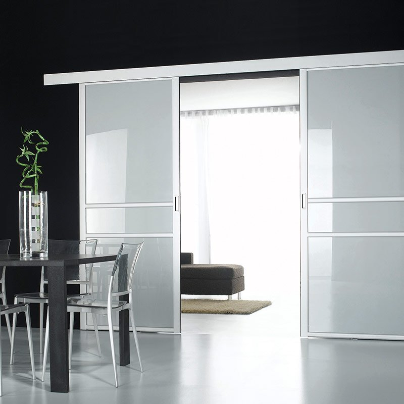 Porte coulissante de salon en verre coulidor rubis les for Amenagement interieur coulissant